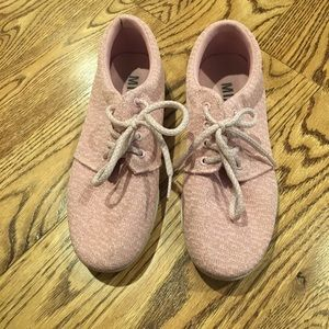 Blush colored sneakers